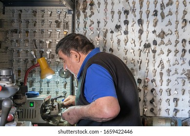 Ermoupolis: February 28th . Key maker working on duplicating key in his workshop. Ermoupolis, Syros February 28th,2020, Greece.