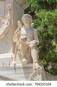 ERMOUPOLIS - JULY 2017: statue in Greek Orthodox cemetery in Ermoupolis, Syros Greece.  The Orthodox cemetery in Syros is full with beautiful marble statues.