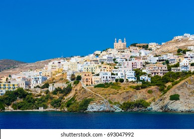 Ermoupolis at Syros island with Anastasi (Resurrection of Christ) church and traditional houses against a blue sky, Greece