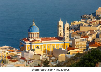 "Ermoupolis at Syros island with ""St Nikolaos of the Rich"" church and traditional houses at dusk, Greece"