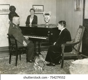 Ernst Roehm, Chief of Sturmabteilung , with his mother, Emilie Roehm, ca. 1933. Standing beside the piano, his sister