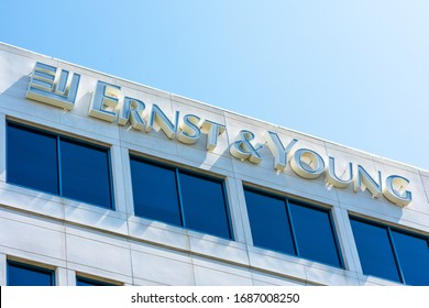 Ernst and Young logo atop of a multinational professional services firm office in Silicon Valley, high-tech hub of San Francisco Bay Area - Redwood City, California, USA - 2019