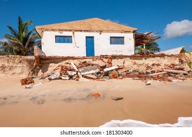 Eroded beach with house, Pititinga, Natal (Brazil)