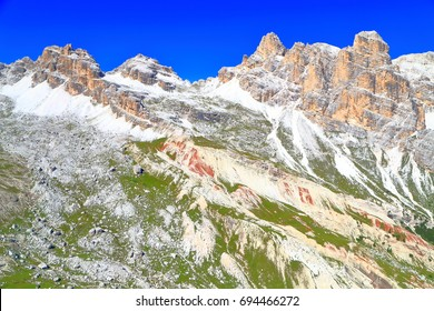 Eroded cliffs and scree covered slopes of Fanes massif, Dolomite Alps, Italy