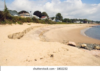 Eroded Connecticut beach shoreline after a storm.