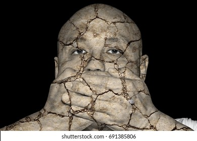 An eroded cracking man covering his mouth with his hand for the concept: Deteriorating Freedom of Speech.