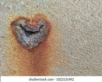Eroded and damaged concrete floor  look like heart shaped. Can used for concept of bleeding love , Valentine 's day and broken heart.