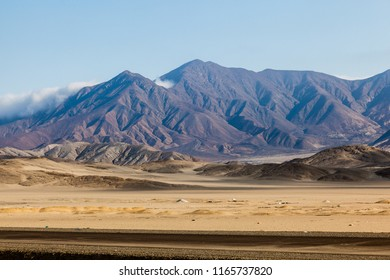 Eroded mountains, dunes and desert along the Peruvian coast north of Lima