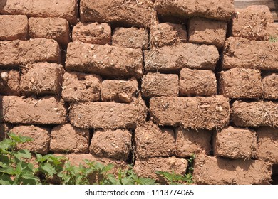 eroded mud brick wall of dried clay and straw, Serbia