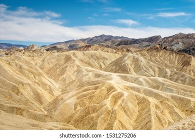 Eroding volcanic ash and silt hills, badlands, at Zabriskie Point, Death Valley National Park, California, USA