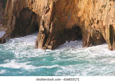 Erosion: 3 Caves Eroded in Different Sizes With the Sea Rushing in