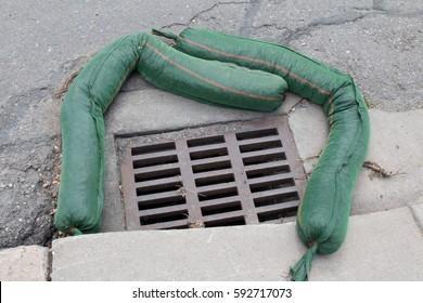 Erosion control sandbags surrounded a storm drain