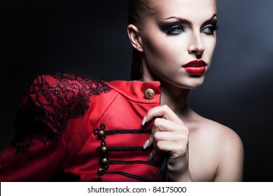 erotic attractive woman in red with blue eyes