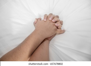 erotic concept of a man hand grabbing other man hand while having sex