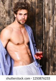 Erotic and desire concept. Guy attractive relaxing with alcohol drink. Man sexy chest sweaty skin hold wineglass. Drink wine and relax. Bachelor enjoy wine. Macho tousled hair degustate luxury wine.