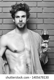 Erotic and desire concept. Guy attractive relaxing with alcohol drink. Man sexy chest sweaty skin hold wineglass. Bachelor enjoy wine. Macho tousled hair degustate luxury wine. Drink wine and relax.