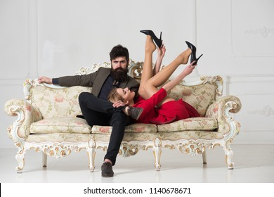 erotic games of sexy couple. erotic games comcept. woman and man play erotic games. erotic games of family couple on sofa. Temptation