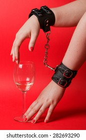 Erotic night - wine and leather handcuffs