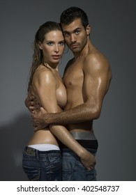 erotic scene of a sexy couple in jeans having sex