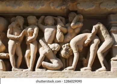 Erotic sculptures at Vishvanatha Temple at the  Western temples of Khajuraho in Madhya Pradesh, India. UNESCO World heritage site.