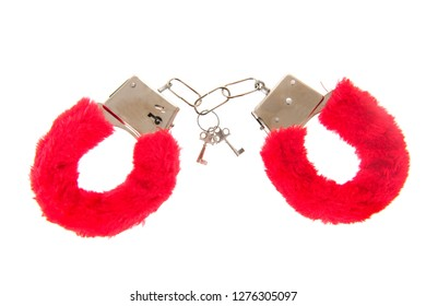 Erotic Sex toy as red hand cuffs isolated over white background