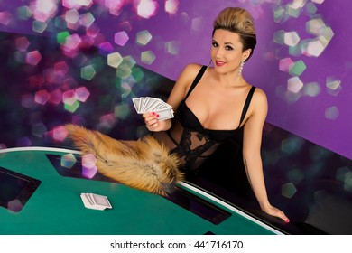 Erotic sexy passion young woman in lingerie model ready to play poker cards in casino