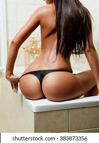 Erotic shot of woman with sexy ass in bathroom
