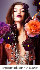 erotic woman with silver accessory in flowers