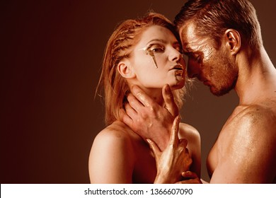 Erotica concept. erotica with couple having golden body and touching each other, copy space