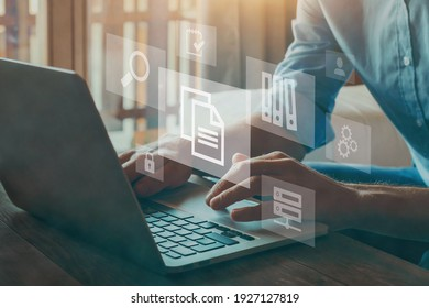 ERP, document management concept with icons on virtual screen - Shutterstock ID 1927127819
