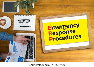 ERP as Emergency Response Procedures Businessman working at office desk and using computer and objects, coffee, top view,