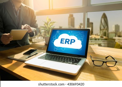 ERP as Emergency Response Procedures Thoughtful male person looking to the digital tablet screen, laptop screen,Silhouette and filter sun
