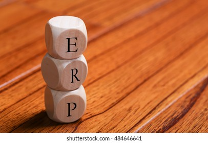 ERP wooden blocks are on the wooden floor background.