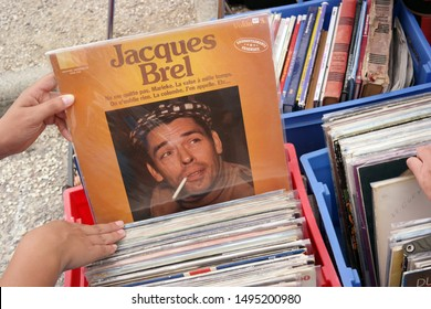 ERQUY, FRANCE - JULY 20, 2014: LP record of the Belgian singer-songwriter Jacques Brel on a flea market.
