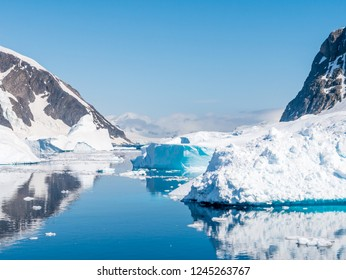 Errera Channel with floating icebergs and ice floes on a sunny day in antarctic summer, Antarctica