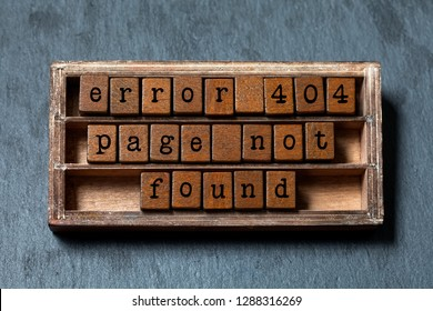 Error 404 page not found concept. Vintage box, wooden cubes with old style letters. Gray stone textured background