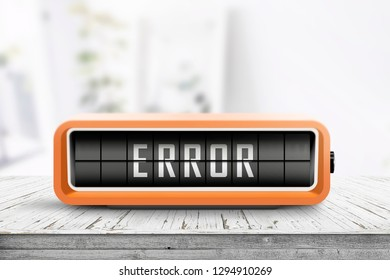 Error message on a wooden desk with a retro alarm clock on a bright day