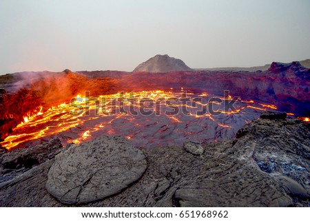 Erta Ale shield volcano in Eastern Ethiopia, erupting lava lake. Visit beautiful places in the world and enjoy traveling to unique sights.