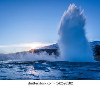 An erupting geyser at the Geysir national park in Iceland.