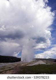 Erupting geyser at Yellowstone National Park, Wyoming, USA