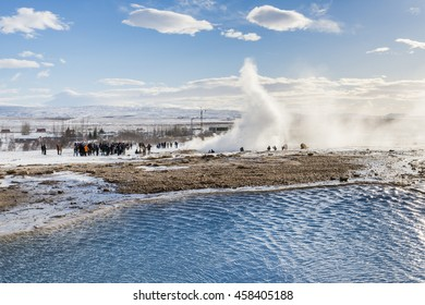 Eruption of the Great Geyser and the blue thermal lake. Strokkur. Iceland.
