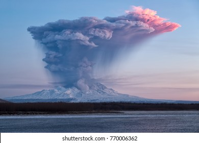 Eruption of the volcano at sunrise . DEC 05,2017:Russia,  Kamchatka Mountain. Shiveluch Volcano.(3307m) Active Volcano Of Kamchatka Peninsula.
