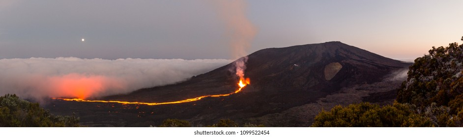 """Eruption of the vulcano """"Piton de la fournaise"""" at the Island of """"La Reunion"""" on September 16th 2016 with glowing clouds and moon"""
