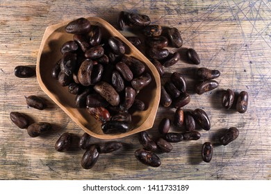 erythrina tree edible seed closeup in a wooden bowl