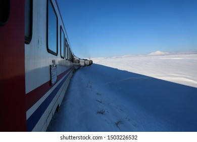 Erzincan / Turkey - February 24, 2016 :  East Express is very popular in Turkey in recent years. The train passes a snowy derail.