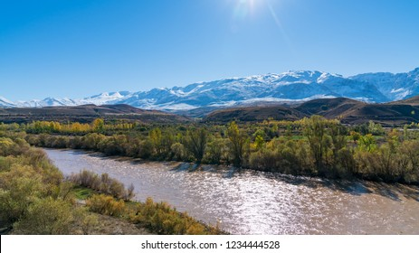 Erzincan, Turkey - October 2018: View of a valley with snow capped mountains and River Euphrates near Erzincan, Turkey