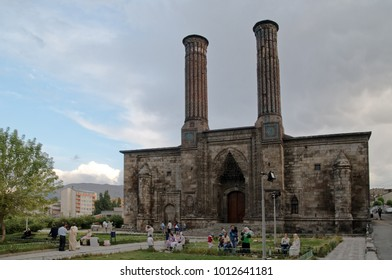ERZURUM, TURKEY - AUGUST 16, 2008: People at the Twin Minaret Madrasa. Built as a theological school a few years before 1265, it takes its name from the two fluted minarets that crown the facade