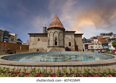 ERZURUM, TURKEY - JUNE 1, 2013: View over Yakutiye Madrassah which was an ancient islamic theology school, with a pool in the park, in Erzurum, Turkey.
