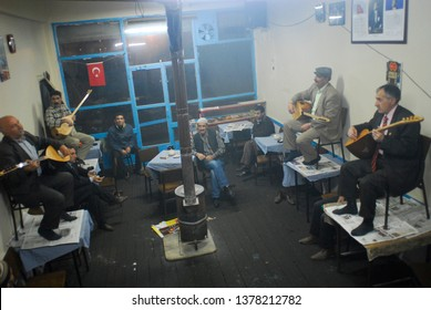 Erzurum, Turkey - November 13, 2008 : Bards playing the traditional music instrument saz and singing mutual poems improvisational call and response düet in Erzurum. İt is an very old mistral tradition