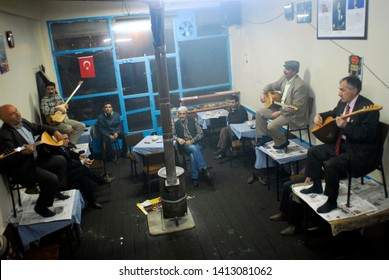 Erzurum, Turkey - November 13, 2008 : The traditional poets playing saz and singing, in Erzurum, north-east Anatolia. Saz is a old traditional turkish instrument.